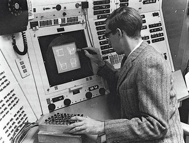 A computer operator using Sketchpad in 1963, the first program to use a graphical user interface.