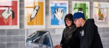 Visitors at the '64 Bits' exhibition which takes place at Here East, on 1 April, in London, United Kingdom.